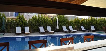 Giritlioglu Butik Otel Havuz / Deniz